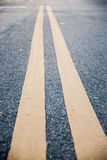 Double yellow lines close up. Stock Photography