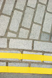 Double Yellow Lines on Cobblestones Stock Photo