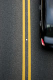 Double yellow lines divider Royalty Free Stock Photo