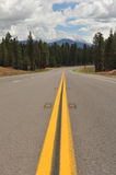 Double Yellow Lines On Road Into The Distance Stock Photography
