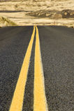 Double yellow lines on paved road Royalty Free Stock Image