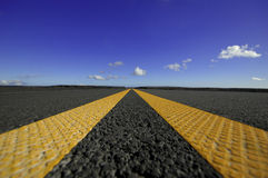Double yellow lines on road Stock Photos