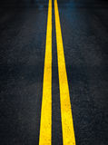 Double yellow lines on road background Royalty Free Stock Photography