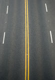 Double yellow lines and white lines divider Stock Photos