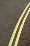 Double Yellows. Simple double yellow lines on highway Royalty Free Stock Photo