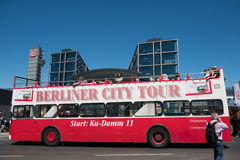 A doubledecker, cabriolet sightseeing bus in Berlin with people. Berlin, Germany - may 27, 2017: A doubledecker, cabriolet sightseeing bus in Berlin with people Royalty Free Stock Images