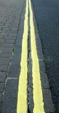 Doubles lignes jaunes photos libres de droits