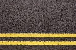 Doubles lignes jaunes Photographie stock libre de droits
