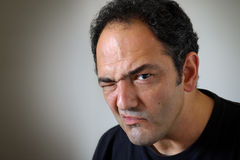 Doubt it. Portrait of a man with a angry and doubtful expression Stock Photography