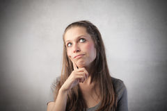 Doubt. Young woman with doubtful expression Royalty Free Stock Image