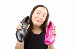 Doubt is black or pink shoes Stock Photo
