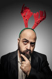 Doubt christmas bearded man with funny expressions. On grey background Royalty Free Stock Photos