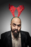 Doubt christmas bearded man with funny expressions Stock Images