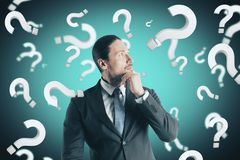 Doubt and confusion concept. Portrait of attractive young european businessman with question marks. Doubt and confusion concept stock illustration