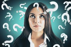 Doubt and confusion concept. Portrait of attractive young european businesswoman with question marks. Doubt and confusion concept stock image