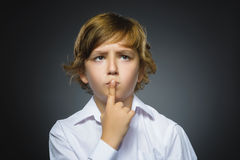 Doubt, expression and people concept - boy thinking over gray background royalty free stock photos