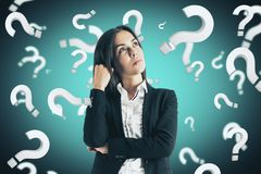 Doubt and faq concept. Portrait of attractive young european businesswoman with question marks. Doubt and faq concept stock image