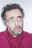 Doubt and imagination concept for mature man. Doubt and imagination concept - portrait of questioning mature man with eyeglasses pouting in thinking,white royalty free stock photo
