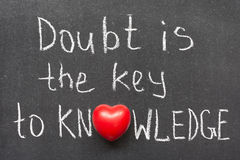 Doubt is. The key to knowledge phrase handwritten on chalkboard with heart symbol instead of O royalty free stock photos