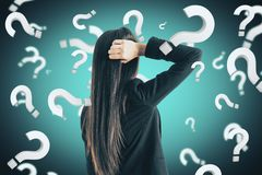 Doubt and stress concept. Portrait of attractive young european businesswoman with question marks. Doubt and stress concept royalty free stock image