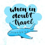 When in doubt travel. Motivational quote at blue Stock Photos