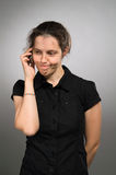 Doubt woman with mobile Royalty Free Stock Photo
