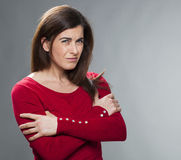 Doubt and worry concept for outraged 30s woman. Doubt and worry concept - portrait of outraged 30s woman questioning or looking deaf with arms folded for Royalty Free Stock Image