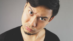 Doubt on you. An asian man with black t-shirt stock photography