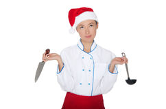 Doubters asian chef in christmas cap with container Stock Photo