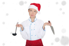 Doubters asian chef in christmas cap with container under snow Stock Photo