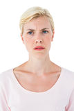 Doubtful blonde woman Stock Images