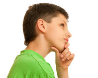 Doubtful boy in green Royalty Free Stock Photography
