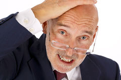 Doubtful business man. Doubtful looking senior business man with glasses (isolated on white Stock Photography