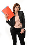 Doubtful business woman or student with portfolio standing and thinking Royalty Free Stock Images