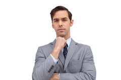 Doubtful businessman looking at camera Stock Images