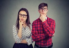 Free Doubtful Couple Looking At Camera Stock Image - 118965351