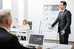 Doubtful employee representing the project in the office Stock Images