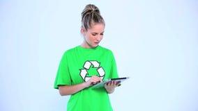 Doubtful environmental activist using a digital tablet stock video