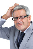 Doubtful handsome businessman posing Royalty Free Stock Images
