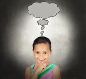 Doubtful little girl with a bubble Royalty Free Stock Images