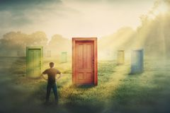 Doubtful man in front of many different doors choosing one. Difficult decision, concept of important choice in life, failure or. Success. Ways to unknown future royalty free stock image