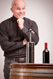 Doubtful man about wine quality controls Royalty Free Stock Photos