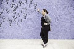 Doubtful pensive girl Stock Image