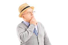 Doubtful senior man in thoughts Royalty Free Stock Photo