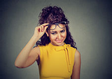 Doubtful skeptical woman thinking looking at you with disapproval. Doubtful skeptical woman in yellow dress thinking looking at you with disapproval Stock Images