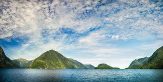 Doubtful Sound Panorama in Fiordland National Park. Doubtful Sound is often described as a quieter version of Milford Sound, it is the lesser known fjord but it Stock Images