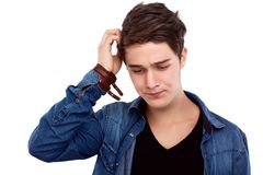 Doubtful young man Stock Image