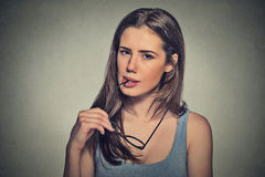 Doubtful young woman Stock Photos