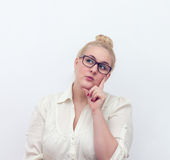 Doubtful young woman thinking, on white Stock Photo
