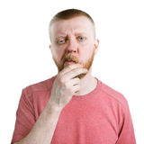 Doubting bearded man in a shirt Royalty Free Stock Photos